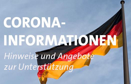 Symbolbild. Deutschlandflagge mit Schriftzügen zu Corona