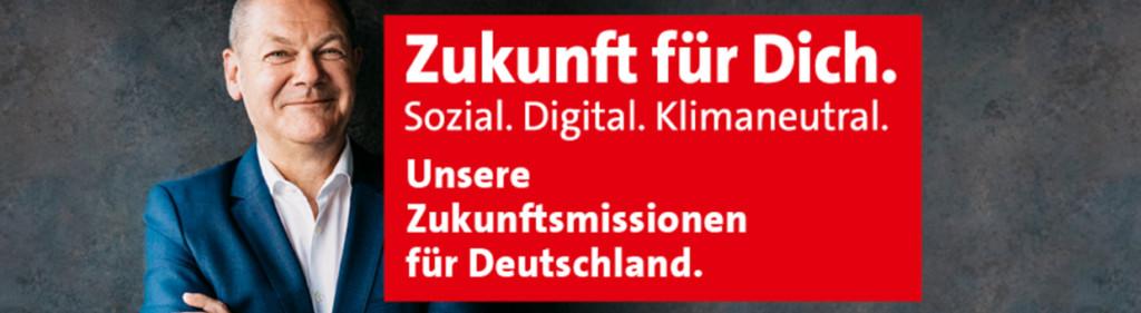 Porträt mit Olaf Scholz und einem roten Banner, auf dem folgender Text steht: Zukunft für Dich. Sozial. Digital. Klimaneutral. Unsere Zukunftsmission für Deutschland